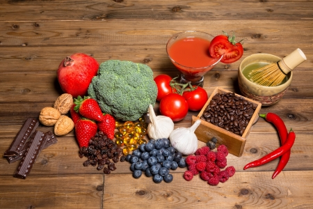 antioxidants: Fresh produce on a wooden table all containing antioxidants