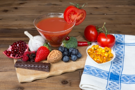 Delicious antioxidants as a colorful mix on a wooden table photo