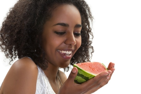 Beautiful African Ethiopian girl eating a juicy watermelon photo