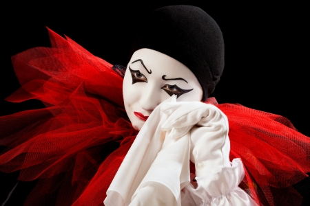 pierrot: Depressed Pierrot crying in a white handkerchief  Stock Photo