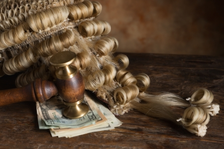 Bribery or corruption in court symbolized with money and a judges wig