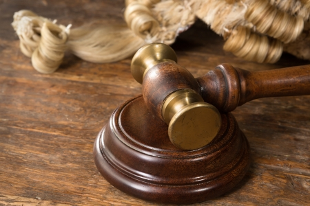 Wooden block, judges wig and gavel on a wooden desk Stock Photo
