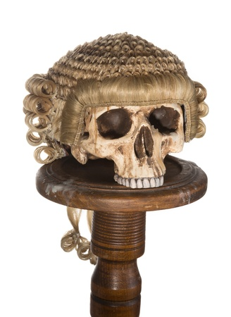 Genuine court wig isolated on a creepy skull Stock Photo