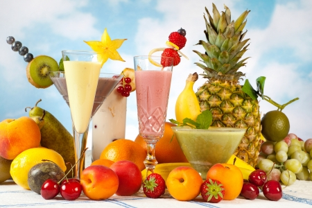 Decorated smoothies and an abundance of summer fruits photo