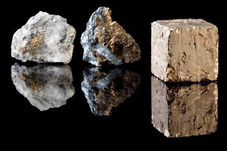 specimen: Chalcopyrite and pyrite in uncut rough state, two minerals often confused with gold.  Pyrite is therefore called Fools Gold Stock Photo
