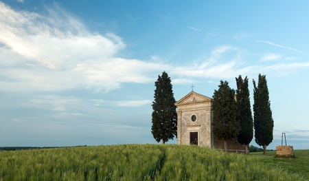 Cappella di Vitaleta in Tuscany, small chapel and cypress trees near Pienza photo