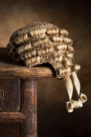 Real horsehair lawyers wig on an antique wooden desk