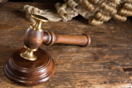 Judges hammer or gavel and his horsehair wig Stock Photo