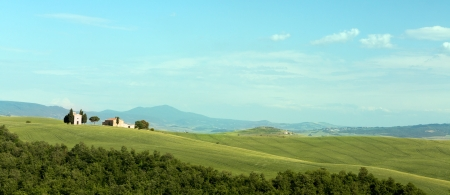 san quirico dorcia: Panoramic view on the Tuscan hills near San Quirico dOrcia with small chapel on rolling hills