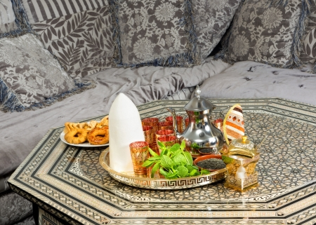 Traditional heavy Moroccan Sugar Cone or Qalib Sukar and tea tray with Ramadan cookies - sugar cones are gifts to mark the birth of babies, weddings or to pay condolences photo