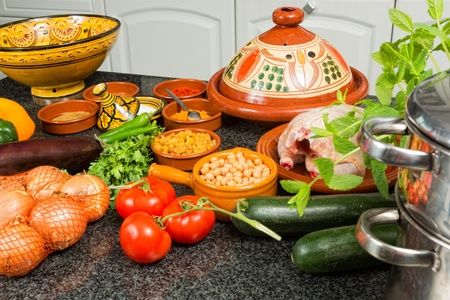 Table filled with ingredients for traditional moroccan tajine dish