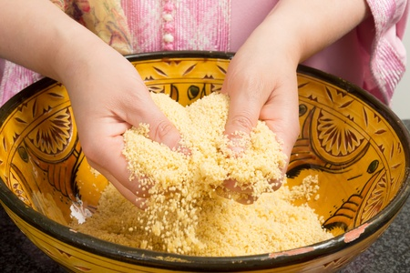 couscous: Traditional Moroccan immigrant woman in Europe cooking couscous during Ramadan