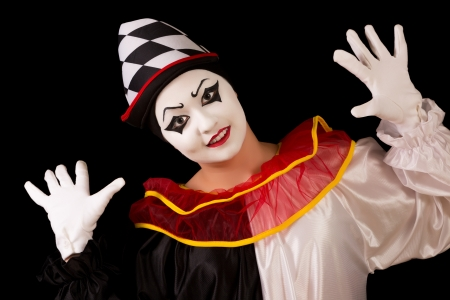 Isolated portrait of a funny happy Pierrot clown photo