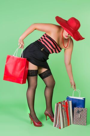 Sexy pin up girl holding paper shopping bags photo