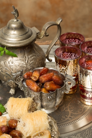 Traditionally dates are eaten at sunset during Ramadan month photo