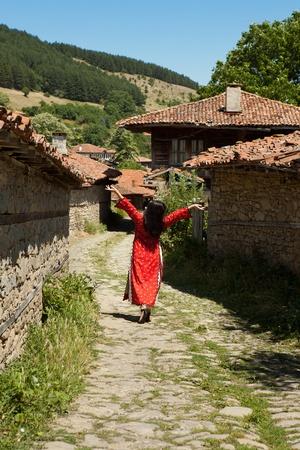 bulgarian ethnicity: Happy woman in Bulgarian national costume dancing in Jeravna village