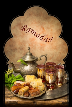 Display of oriental cookies and iftar dates on a Moroccan tea tray photo