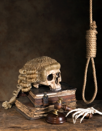 Symbols of death penalty like noose, judges wig and skull Stock Photo