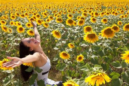 bulgaria girl: Cheerful singing woman in a bulgarian sunflower field