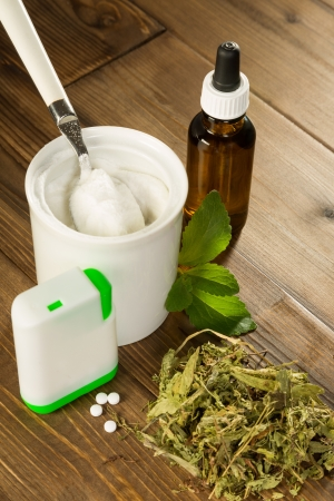 sugar powder: Powder stevia and liquid, dried and tablet forms on a wooden table