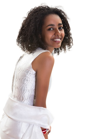 Pretty young Ethiopian woman smiling on a white background photo