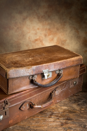 stacked: Two closed very old leather vintage suitcases with copyspace