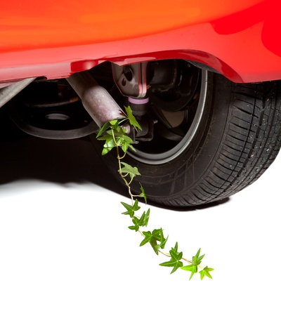 Environmental car with ivy coming out of the exhaust instead of smoke photo
