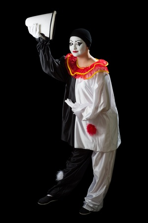 Mime Pierrot isolated on black greeting with her hat photo