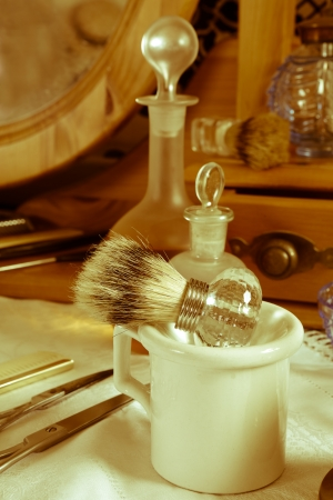 Old times barber shop with shaving brush and other antique tools photo