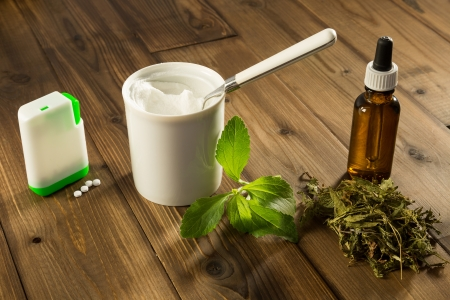sweetener: White tablets and green leaves of natural sweetener stevia