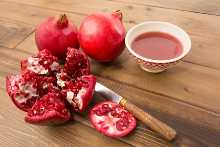 tannins: Juicy pomegranates fresh and cut on a wooden table