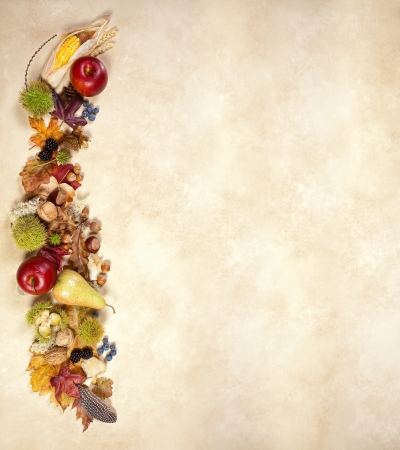 Vertical composite of autumn fruits leaves and nuts on jute photo