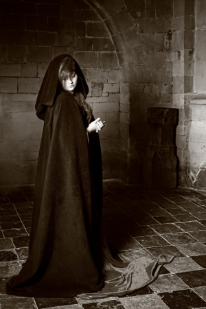 Monochrome image of a medieval castle and a gothic woman
