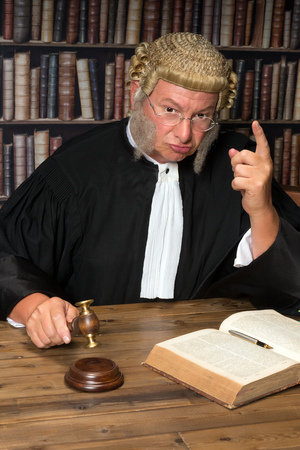 Judge giving a criminal a warming after his desicion