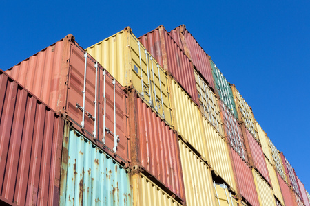 shipped: Stacked containers waiting to be shipped in Antwerp world harbor