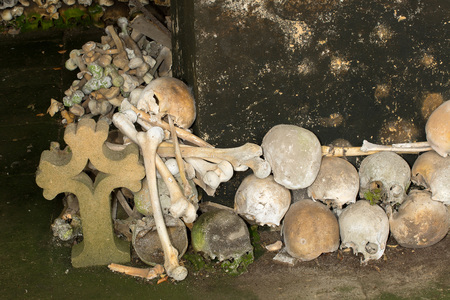 catacomb: Stacked skulls inside the ossuary of Marville, France, with thousands of ancient skulls of 19th century and older