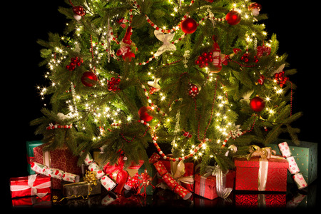 under tree: Colorful gifts and presents under a beautiful christmas tree