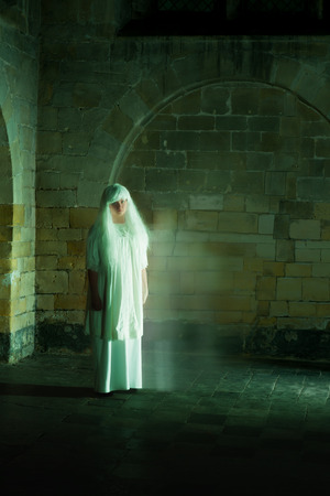 sleepwalker: Night scene in a medieval castle with a woman ghost