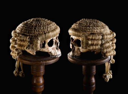 Halloween image of two skulls with judges wigs