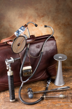 medical instruments: Doctors bag and antique medical instruments such as stethoscope, reflex hammer and head mirror