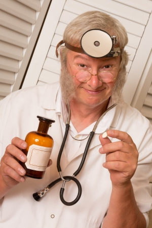 Vintage doctor telling the patient to open his mouth for a big pill Stock Photo - 22732876