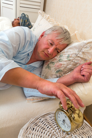 Senior man in bed with his wife early morning photo