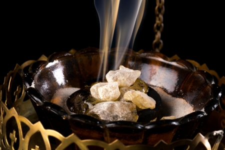 frankincense: Closeup of real smoking church incense on burning charcoal