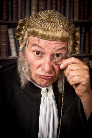 court judge: Vintage judge looking through a monocle in court Stock Photo