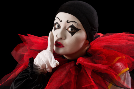 pierrot: Funny Pierrot with her finger against her mouth  Stock Photo