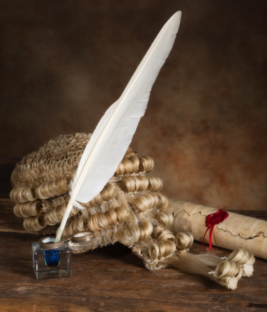 Authentic judges wig with feather quill and scroll parchment Stock Photo