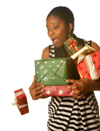 Attractive african young lady dropping her christmas presents photo