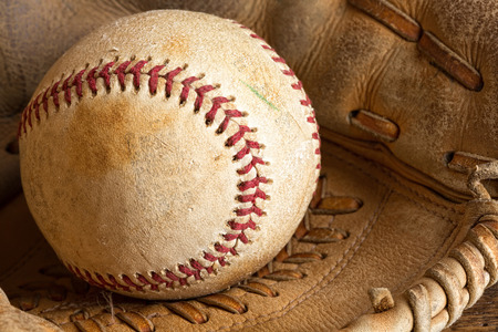 Detail of an old baseball in a weathered glove Stock Photo