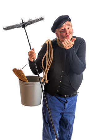 chimney sweep: Funny chimney sweep offering a kiss for good fortune