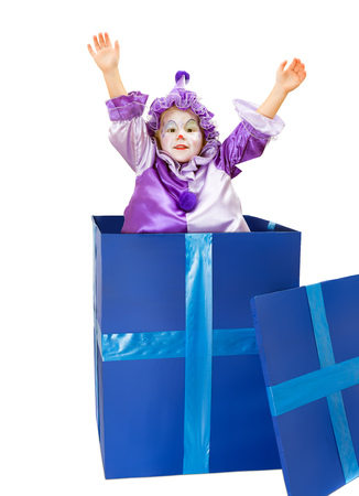 harlequin clown in disguise: Happy little clown girl popping out of a surprise box